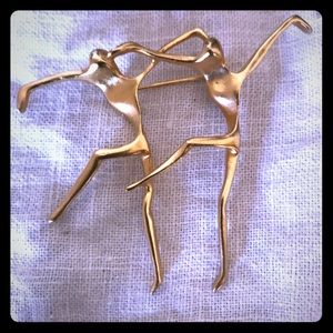Vintage goldtone modern dance pin/brooch 80's